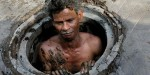 Slideshow: Is this the worst job in the world? Indian-Sewer-man