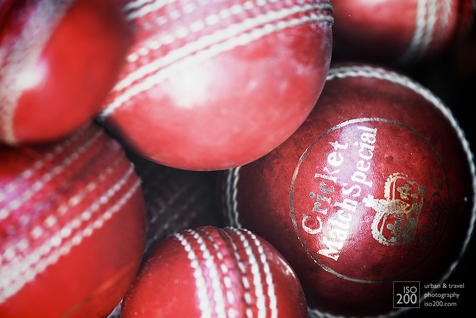 Close up photo of a pile of cricket balls in the shop window of an antique store, Causewayside, Edinburgh