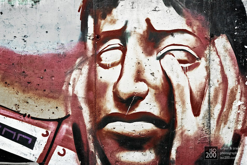 The face of a crying man - urban graffiti from Granada in Spain.