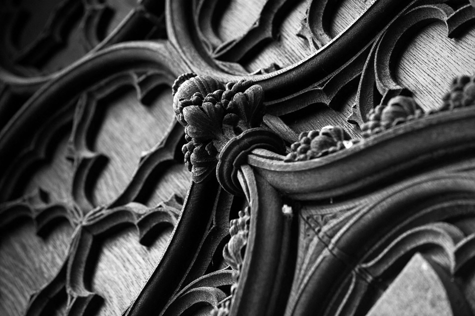 Black and white detail of elaborately carved wooden door at York Minster.